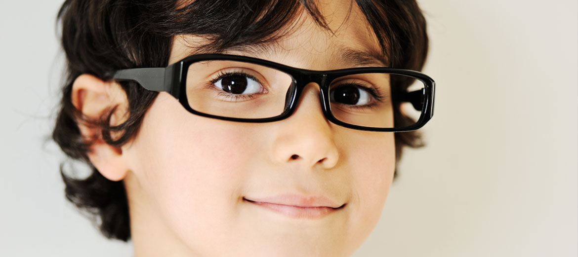 boy smiling wearing nice glasses frames