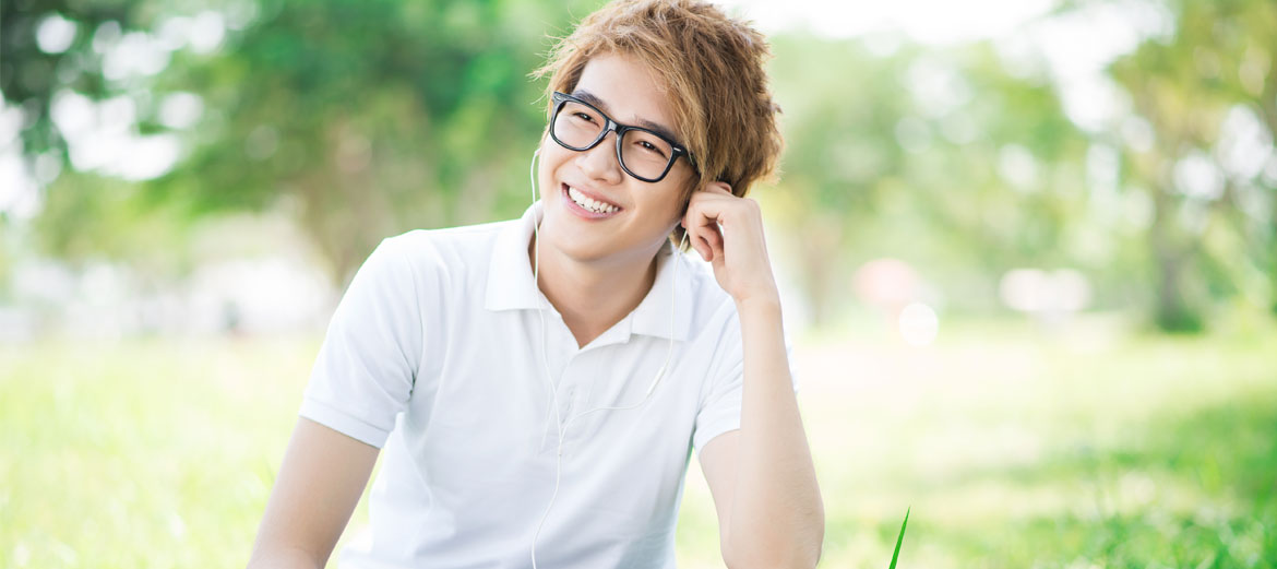 man smiling and wearing glasses
